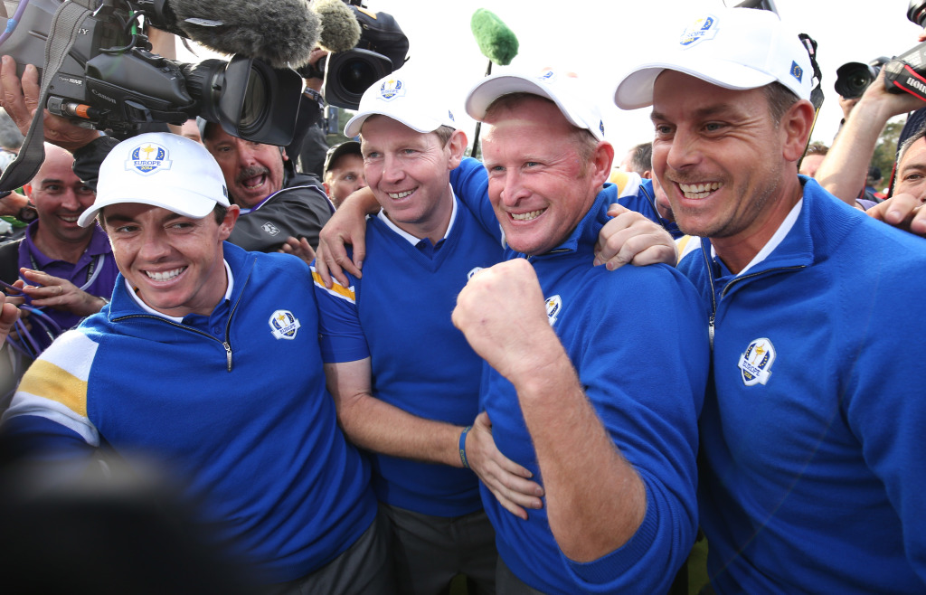 From left, Europe's Rory McIlroy, Stephen Gallacher, Jamie Donaldson and Henrik Stenson  celebrate winning the 2014 Ryder Cup . The Associated Press