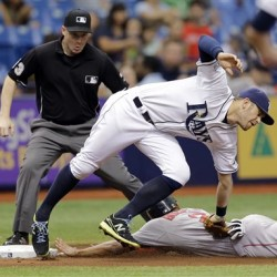 Rays third baseman Evan Longoria stretches to tag out  Xander Bogaerts at third base on a stolen base attempt during the fifth inning Monday in St. Petersburg, Fla. The Associated Press