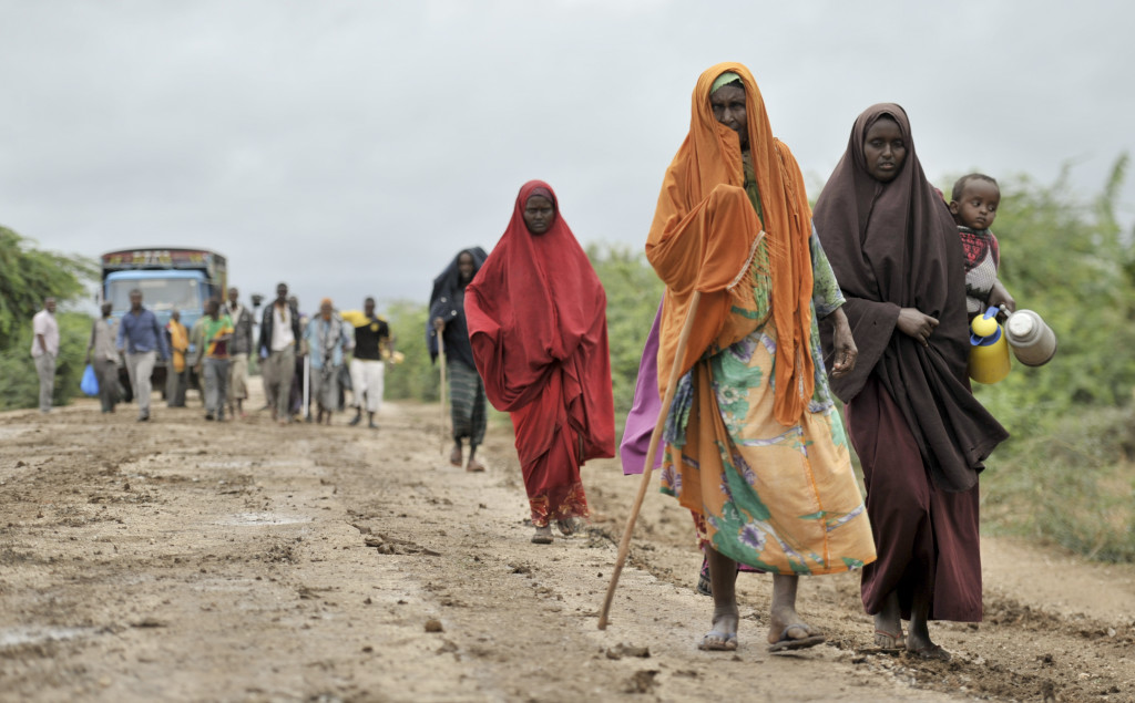 In this photo provided by the African Union Mission to Somalia, civilians who had left the town of Bulomarer when it was held by al-Shabab militants, return Sunday following the town's capture by African Union (AU) and Somali government soldiers. The Associated Press