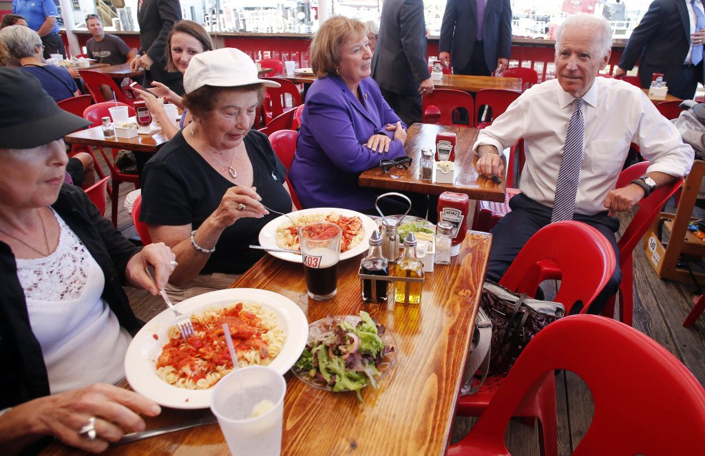 Vice President Joe Biden takes a seat with Rep. Carol Shea-Porter, D-N.H., while stopping for lunch at the Old Ferry Landing restaurant in Portsmouth, N.H., on Wednesday.