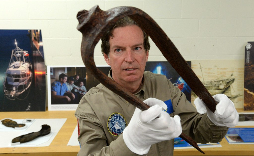 John Geiger, president of the Royal Canadian Geographical Society, holds an iron fitting identified as a davit from a Royal Navy ship. The artifact is considered the key piece of evidence that led to the discovery of a ship believed to be one of two fabled British explorer ships from the Franklin Expedition. The Associated Press / The Canadian Press, Sean Kilpatrick