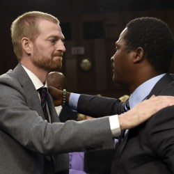 Ebola survivor Dr. Kent Brantly, left, former Medical Director of Samaritan's Purse Ebola Care Center in Monrovia, Liberia, gives a hug to Ishmeal Alfred Charles, right, an aid worker from Sierra Leone, after they both testified before the Senate Appropriations Subcommittee on Labor, Health and Human Services Tuesday on Capitol Hill in Washington.
