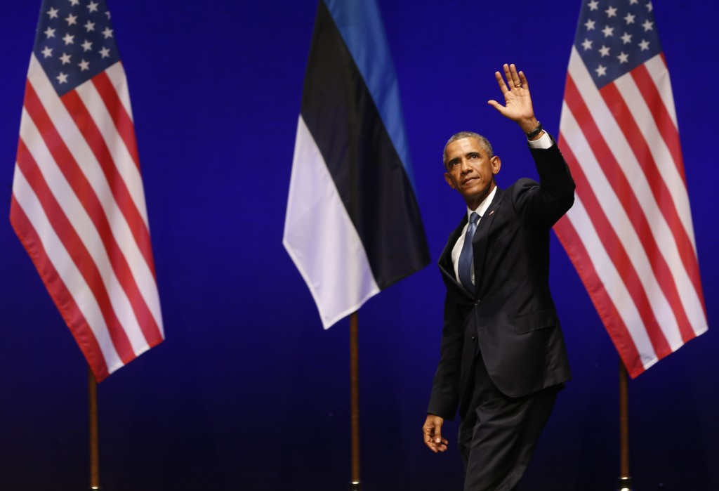 U.S. President Barack Obama waves after speaking at Nordea Concert Hall in Tallinn, Estonia, on Wednesday. Obama is in Estonia for a one-day visit where he will meet with Baltic State leaders before heading to the NATO Summit in Wales.