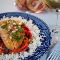 For this fish tagine, a mixture of tomatoes, eggplant, onions and peppers is gently simmered then pieces of halibut, or other fish, are added. The whole cooks into a savory stew laced with warm spices.