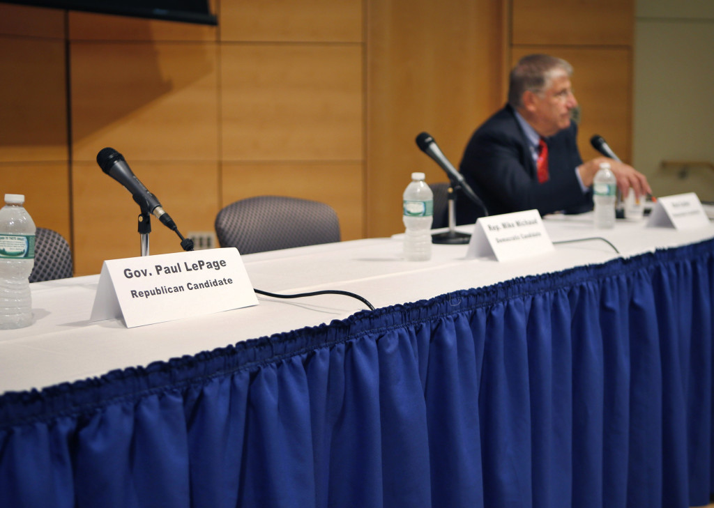 A seat at a table reserved for Gov. Paul LePage remains vacant after the governor decided to pull out of an energy forum at the University of Southern Maine in Portland on Friday. The Associated Press / Robert Bukaty