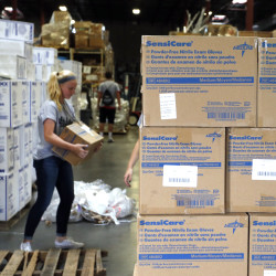 A volunteer in Centennial, Colo., loads a pallet with medical supplies bound for Sierra Leone to combat Ebola. The Associated Press