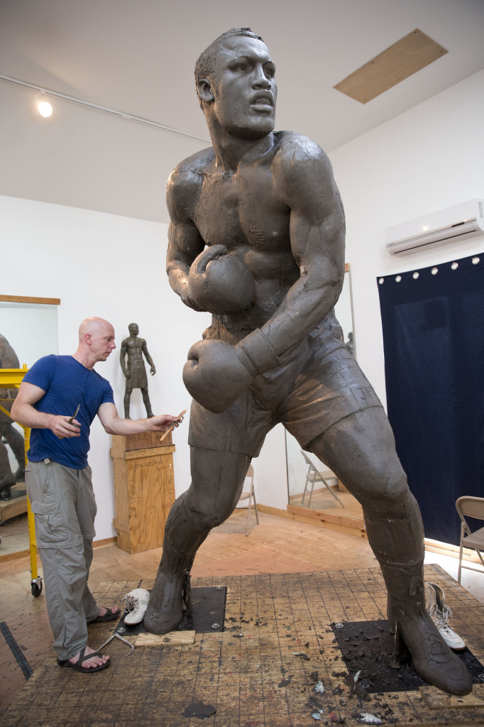 Artist Stephen Layne works on a sculpture of boxing heavyweight champion Joe Frazier in Philadelphia.