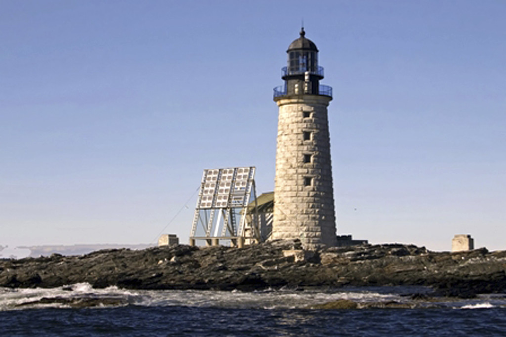 This undated photo released by the federal General Services Administration shows the Halfway Rock Light Station on a small island in Casco Bay off Harpswell. The administration is the nearing the end of an online auction for the 76-foot-high lighthouse, with a half dozen bidders and a high bid of more than $200,000.