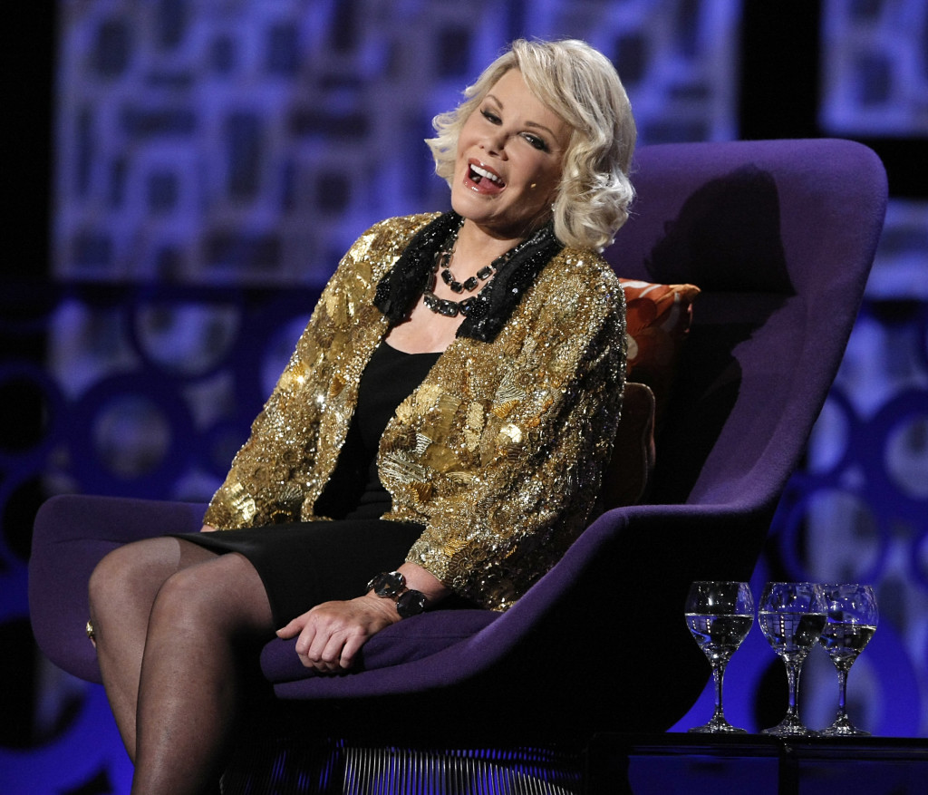 "Joan Rivers greets the audience at the ""Comedy Central Roast of Joan Rivers"" in Los Angeles in July 2009."