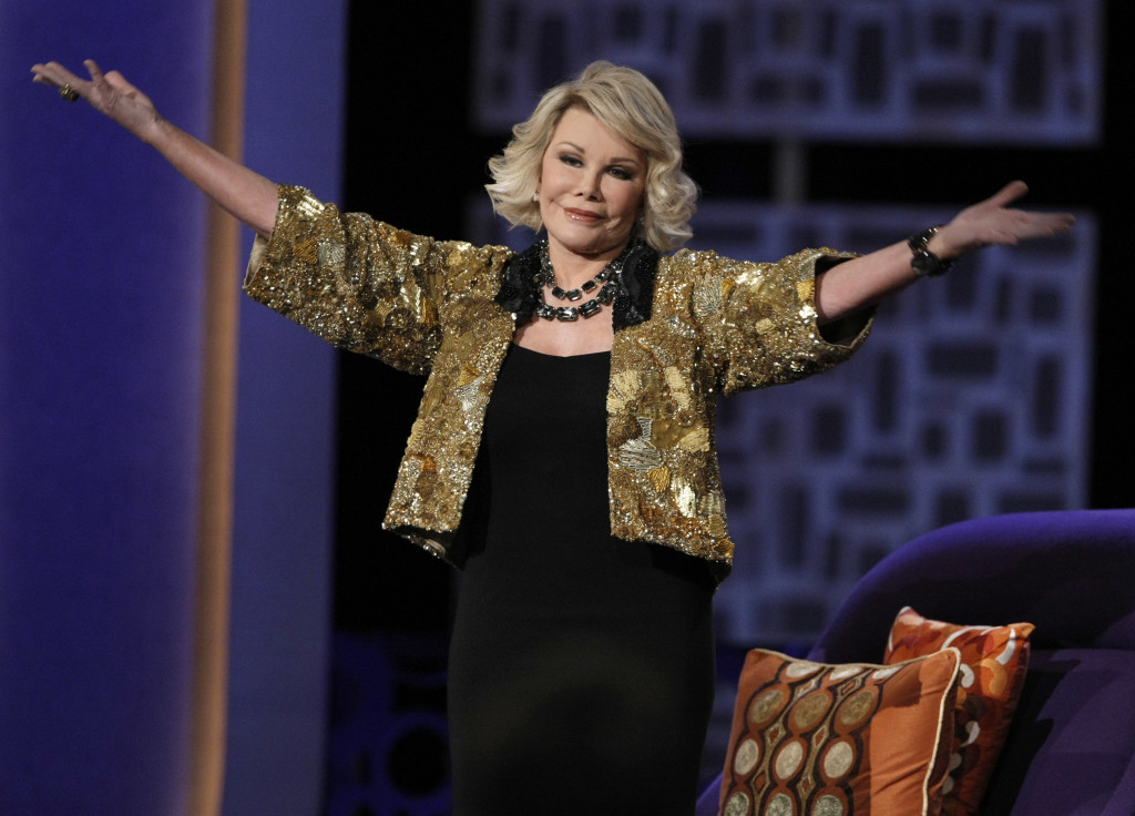 "Joan Rivers greets the audience at the ""Comedy Central Roast of Joan Rivers"" in 2009."