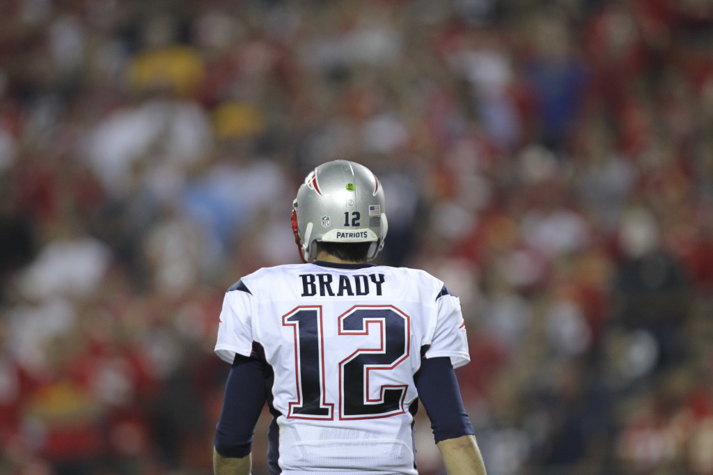 Patriots quarterback Tom Brady looks to the sidelines during the fourth quarter of Monday night's romp by the Kansas City Chiefs. Brady threw two interceptions in the game and lost a fumble.
