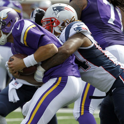 Minnesota Vikings quarterback Matt Cassel, left, is sacked for an 8-yard loss by New England Patriots linebacker Dont'a Hightower during the third quarter Sunday. The Associated Press