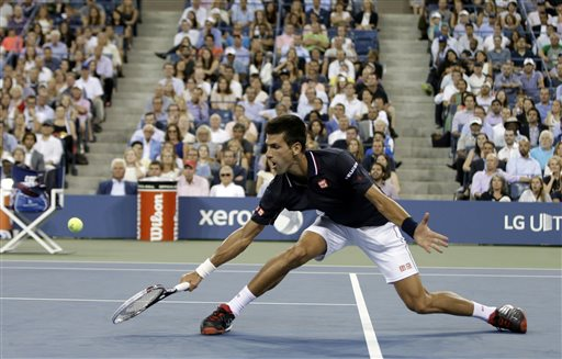 Novak Djokovic of Serbia returns a shot to Andy Murray of Britain in their quarterfinal match at the U.S. Open tennis tournament Wednesday in New York. The Associated Press