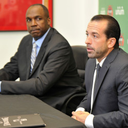 Maine Red Claws president Dujuan Eubanks, left, looks on as the new head coach, Scott Morrison, speaks to the media at a press conference at the team's Congress Street office. Gordon Chibroski / Staff Photographer