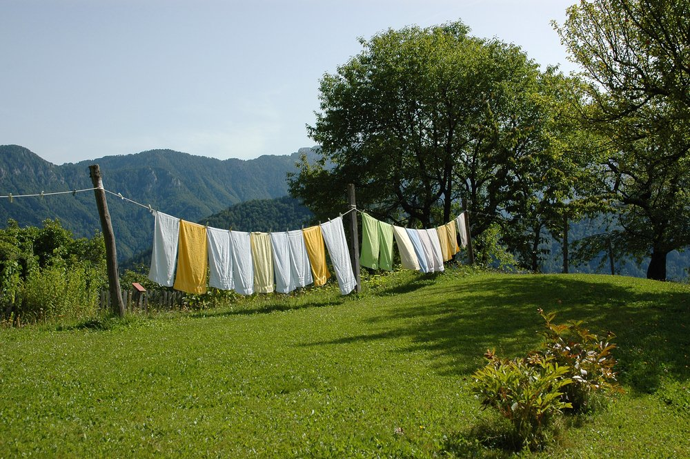 Drying laundry outside in the sun adds a fresh scent that comes from nature, not chemicals.