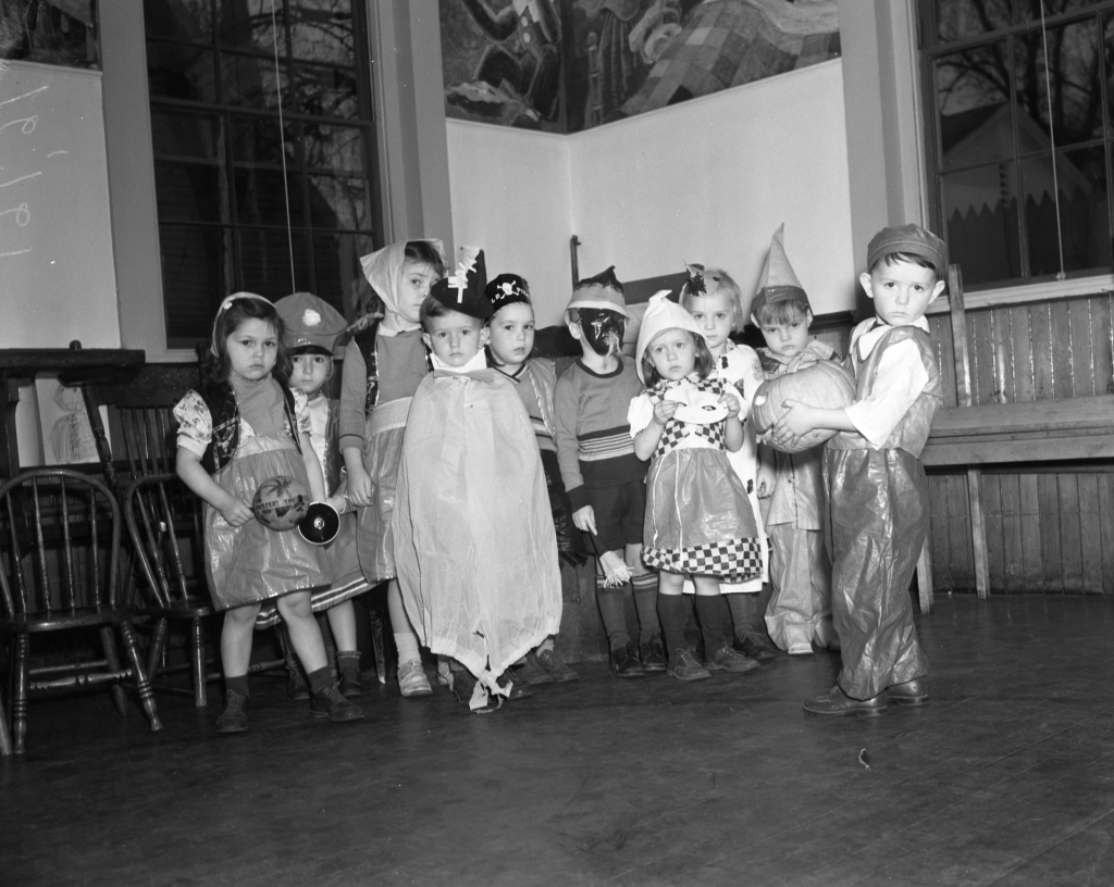 "Oct. 31, 1939 Evening Express. Uncredited. Original caption: ""Bobby Doherty of Monument Street Kindergarten holds his Jack O-Lantern for all to see. The other masqueraders, at the same school, are Carol Thurman, Elaine Silverman, Jean Black, Billy Gilman, Beatrice Wilson, Ronnie Brett, Dorothy Sullivan, Cecil Wheeler and Betty Ann Peterson."""