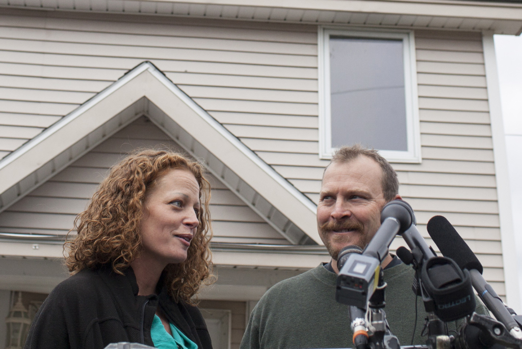 Ted Wilbur and Kaci Hickox address members of the media in the driveway of his home in Fort Kent on Thursday. Wilbur said the pair aren't trying to make anyone in the town uncomfortable, and are only trying to catch up with regular routines now that Hickox is back home after caring for Ebola patients in Sierra Leone.