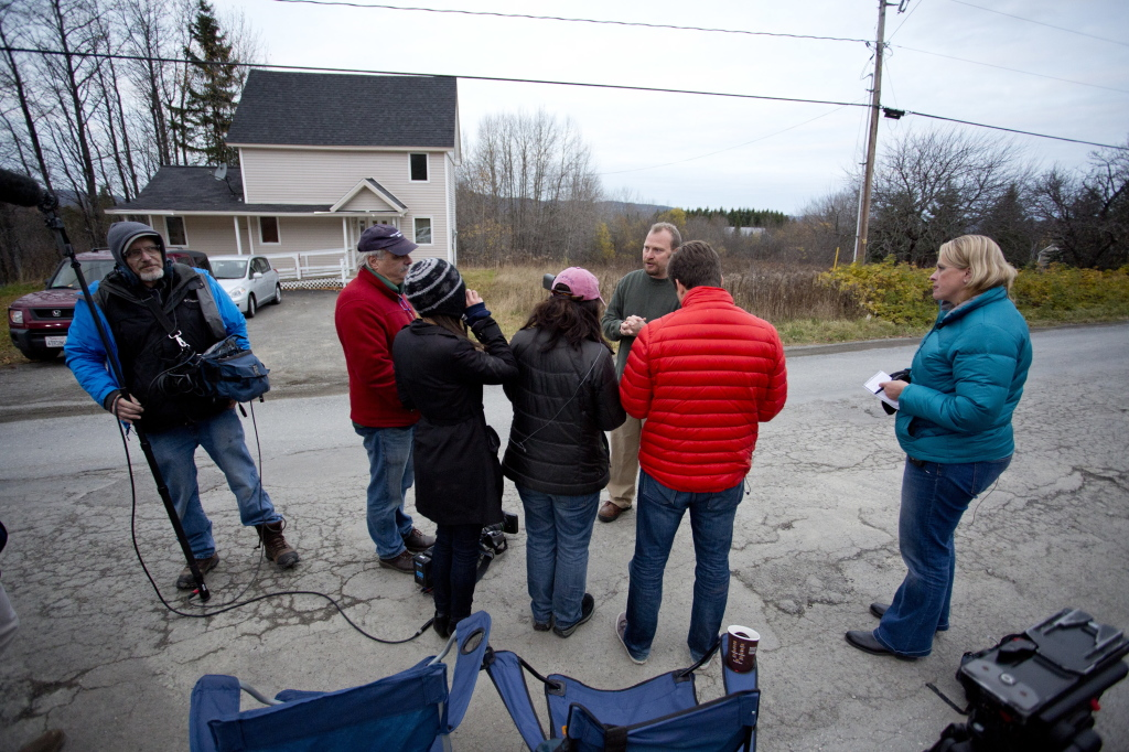 Ted Wilbur addresses the media outside his house in Fort Kent after a worker from the Maine Center for Disease Control revisited the house to retake the temperature of Kaci Hickox, Wilbur's girlfriend, on Friday.