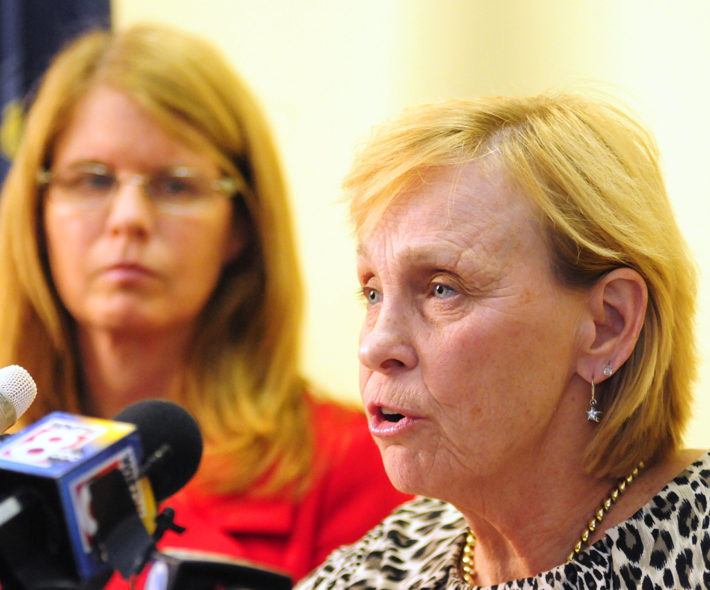 State Health and Human Services Commissioner Mary Mayhew, left, listens as Dr. Sheila Pinette, director of Maine Center for Disease Control and Prevention, talks about the state's response to travelers who've been exposed to the Ebola virus, during a news conference Wednesday in Augusta.
