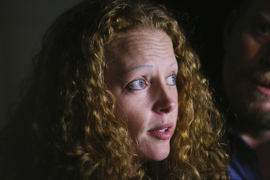 Kaci Hickox speaks to reporters Wednesday night in Fort Kent.