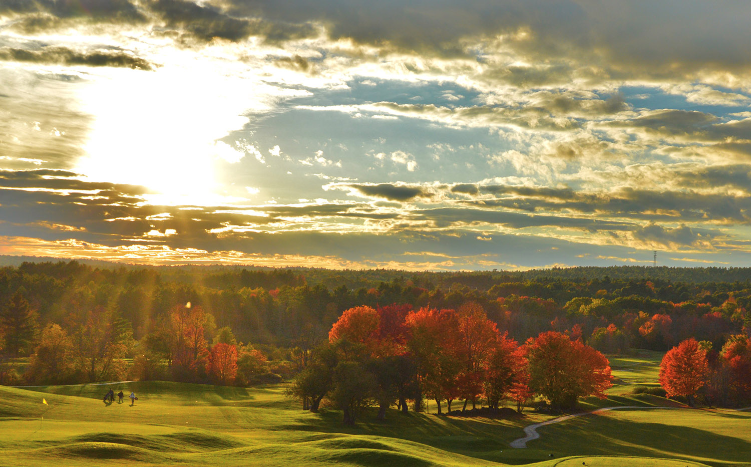 To many of us, golf courses are indeed hallowed grounds, albeit with profanities, and the rays look heaven-sent on the 18th hole at Gray's Spring Meadows, where Yarmouth's Brian Lovering was finishing a round.