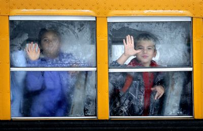 "Gabe Souza's ""Frosty window,"" a photograph of two children looking out a frost-covered bus window, won first place in the feature photo category of the Maine Press Association's annual contest."