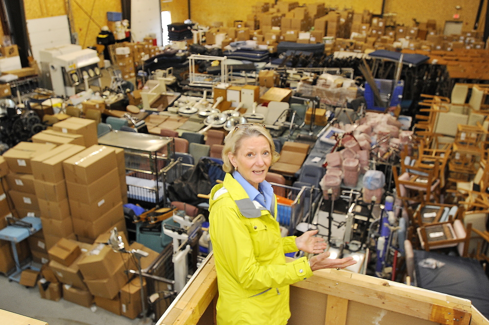 Elizabeth McLellan, founder of Partners for World Health, stands inside a Scarborough warehouse jam-packed with medical equipment bound for countries such as Uganda and Libya.