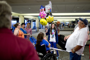 Kelsey Tripp of Winterport shares a laugh with supporters after she and Scott Allen of Kittery (not pictured) were greeted at the Portland International Jetport Monday, August 3, 2015, after they won gold medals at the Special Olympics in California. Tripp won gold in the 50 meter freestyle swim and won silver in the 50 meter backstroke. Allen won gold in golf.  Gabe Souza/Staff Photographer