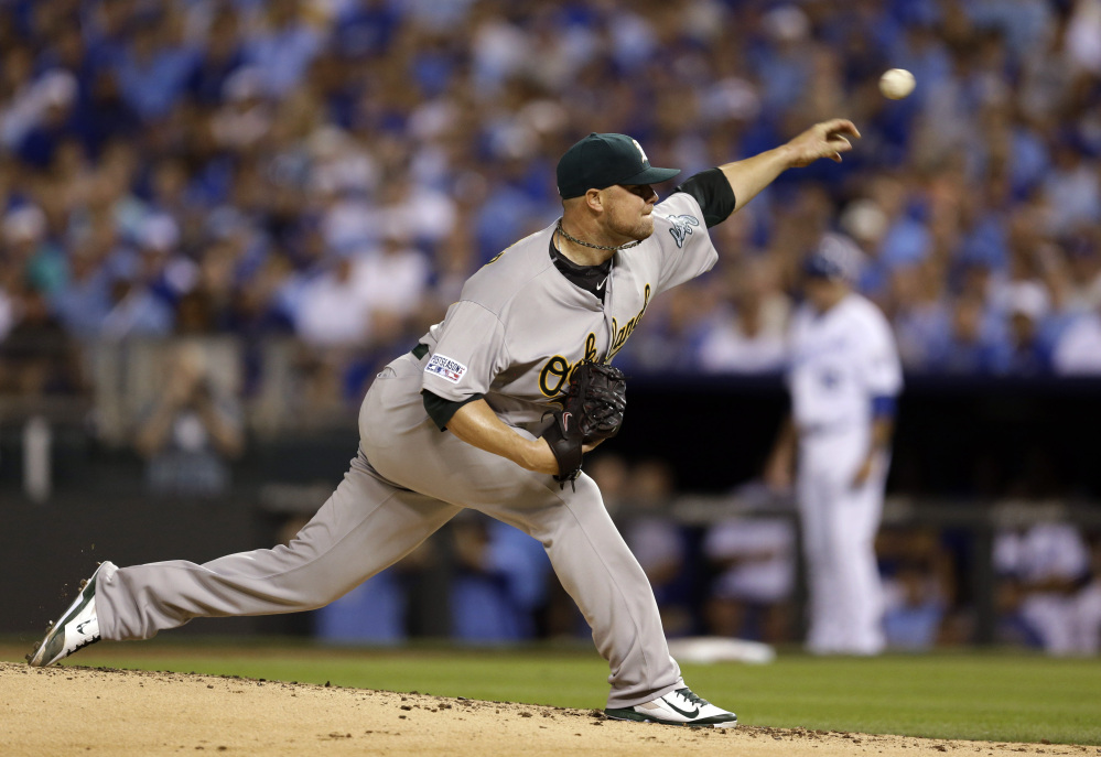 Oakland Athletics starting pitcher Jon Lester throws during the first inning of the AL wild-card playoff game Tuesday night in Kansas City. He took a four-run lead into the eighth inning but Oakland couldn't hold on.