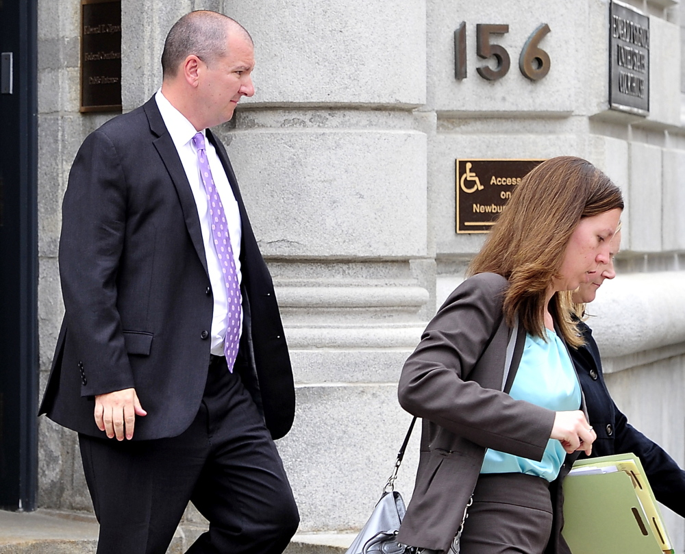 Jeffrey Burnham leaves U.S. District Court in May with his lawyers and family.