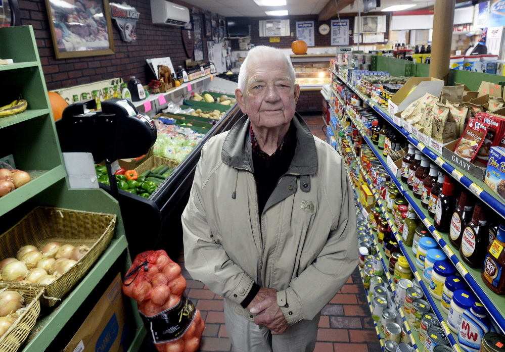 Moran's Market owner Bernie Larsen, 85, works six days a week at his store on Forest Avenue in Portland's Riverton neighborhood. He says the personal touch is important and he enjoys interacting with his customers.