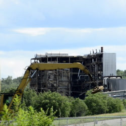Heavy machinery chips away at what remains of the Great Northern Paper Co. mill in East Millinocket.