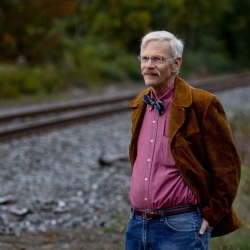 "Chalmers Hardenbergh near a railroad in Freeport Wednesday. He said the Pan Am Systems suit against him and his newsletter took ""a significant amount of my time, but I've enjoyed it because I felt the law was on my side."""
