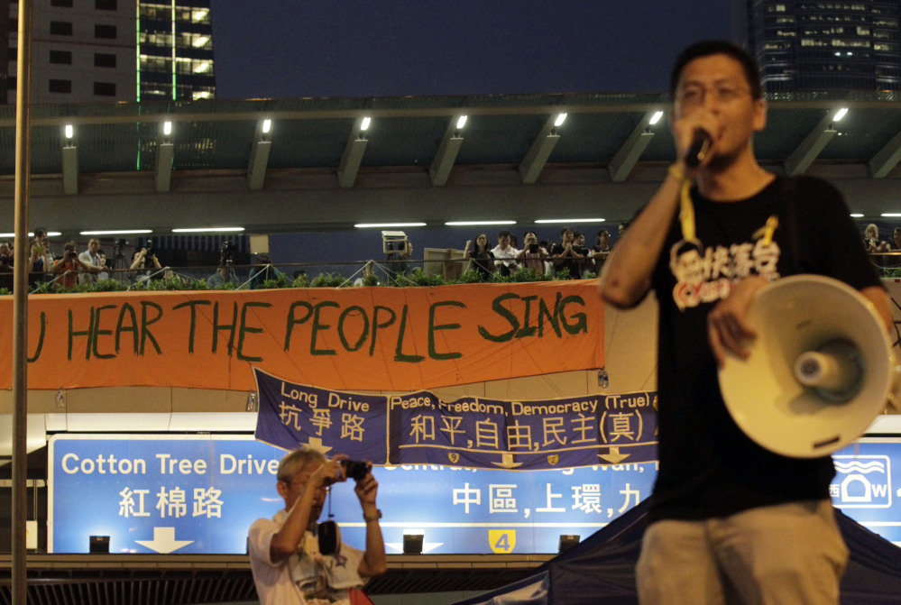 A demonstrator delivers a speech to some of the tens of thousands of protesters in Hong Kong.