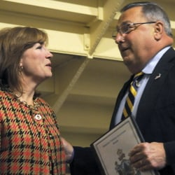 Susan Dench speaks Tuesday with Gov. Paul LePage before the state Senate voted against her nomination to the University of Maine System board of trustees.