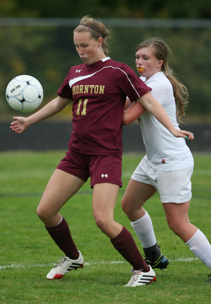 Skye Murray of Thornton Academy, left, blocks Cheverus' Willa Tarasevich in the second half Wednesday at Portland. Thornton Academy won its third straight and improved to 7-1 with a 6-0 win.