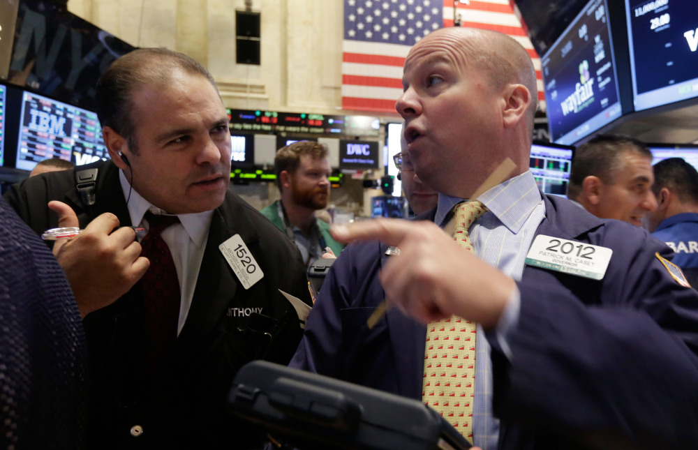 Traders Anthony Riccio, left, and Patrick Casey work Thursday on the floor of the New York Stock Exchange in the wake of a selloff the day before.