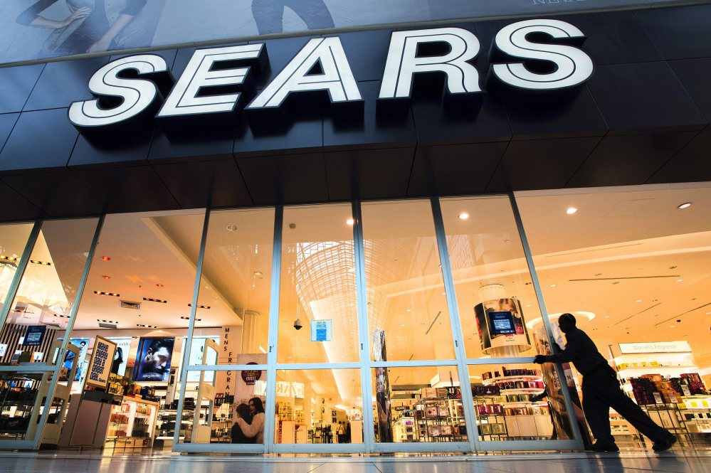 The Sears store at Eaton Centre in Toronto opens its doors for business in this Oct, 29, 2013, file photo. Sears, sorely in need of cash, is selling most of its stake in its Canadian unit to raise as much as $380 million.