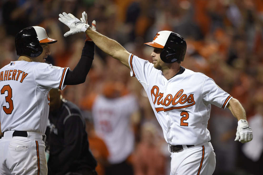 The Associated Press Baltimore Orioles' J.J. Hardy is met at the plate by Ryan Flaherty after his solo home run in the seventh inning against the Detroit Tigers on Thursday in Baltimore.