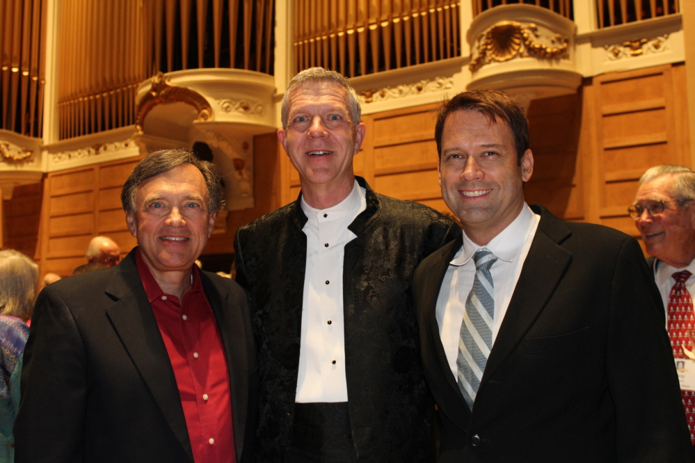 Bob Russell, left, music director of the Choral Art Societ; Ray Cornils, municipal organist, and Robert Moody, music director of the Portland Symphony Orchestra, at the Friends of the Kotzschmar Organ celebration of the instrument's restoration.