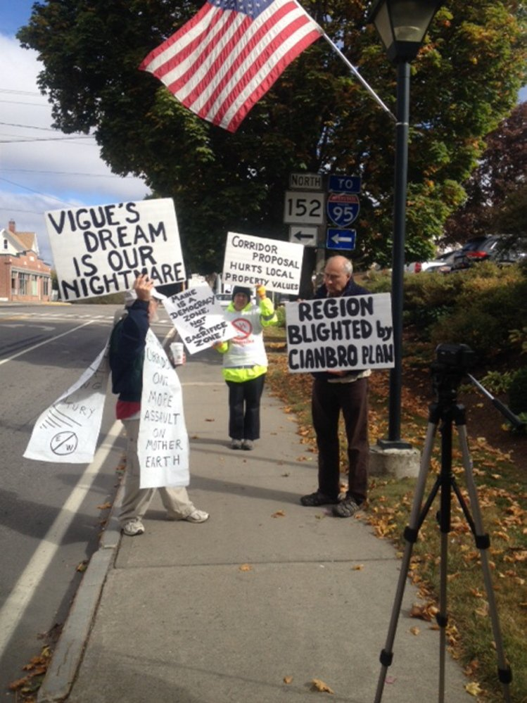 Members of Friends of Piscataquis Valley demonstrate Friday outside the offices of Cianbro Corp. in Pittsfield to protest a proposed East-West Corridor. Cianbro President Peter Vigue has developed a plan for the toll highway connecting Maine to Canada. Protesters say the highway will likely cut through Maine towns, likely including Dover Foxcroft, and destroy the natural beauty of the state.