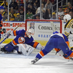 Goalie Chad Johnson of the New York Islanders reaches to make a save on Carl Soderberg of the Boston Bruins during the first period of the Bruins' 6-1 victory Friday night in an exhibition game at Bridgeport, Conn.
