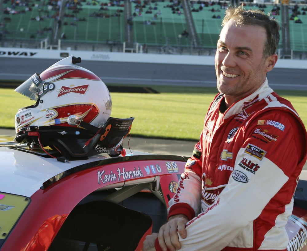 Kevin Harvick smiles after winning the pole position for Sunday's NASCAR Sprint Cup race at Kansas Speedway in Kansas City, Kansas, on Friday.