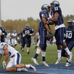 Maine's Arthur Williams celebrates with teammate Jordan Dunn  at Alfond Stadium in Orono last fall.