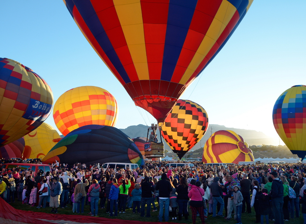 A balloon lifts off  over the crowd Saturday morning during the annual Albuquerque International Balloon Fiesta in Albuquerque, N.M. Organizers have equipped all 550 pilots with tablet computers capable of running a mapping application that will enable them to steer clear of the many restricted areas and prohibited zones. The Associated Press
