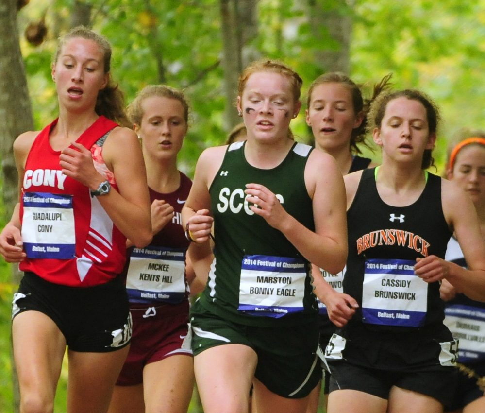 Cony's Anne Guadalupi, left, Bonny Eagle's Kialeigh Marston, center, and Brunswick's Tessa Cassidy are among the early leaders in the girls' race Saturday in Belfast.