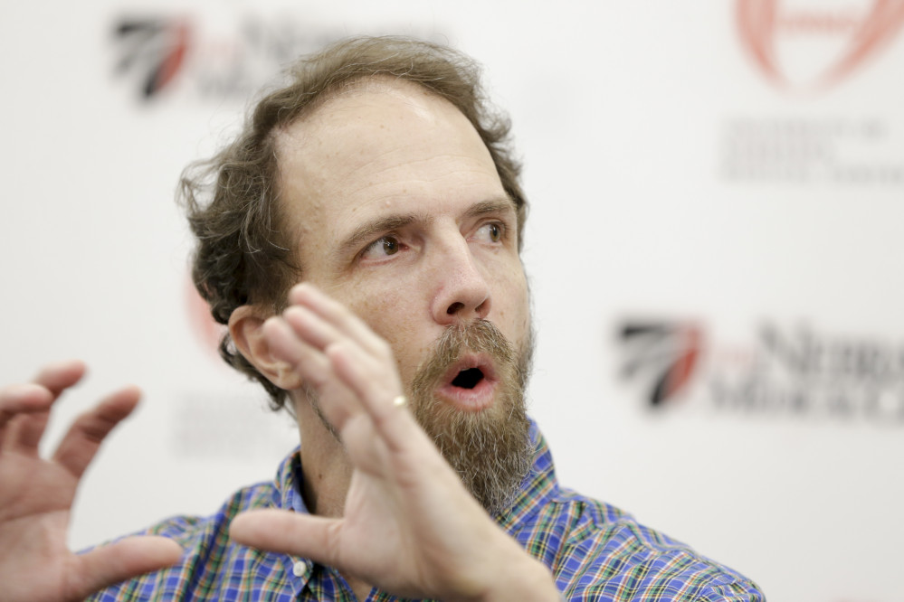 Former Ebola patient Dr. Richard Sacra participates in a news conference at the Nebraska Medical Center in Omaha, Neb.