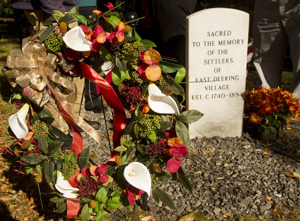 A wreath sits next to a memorial stone for the early settlers of East Deering. Carl D. Walsh/Staff Photographer