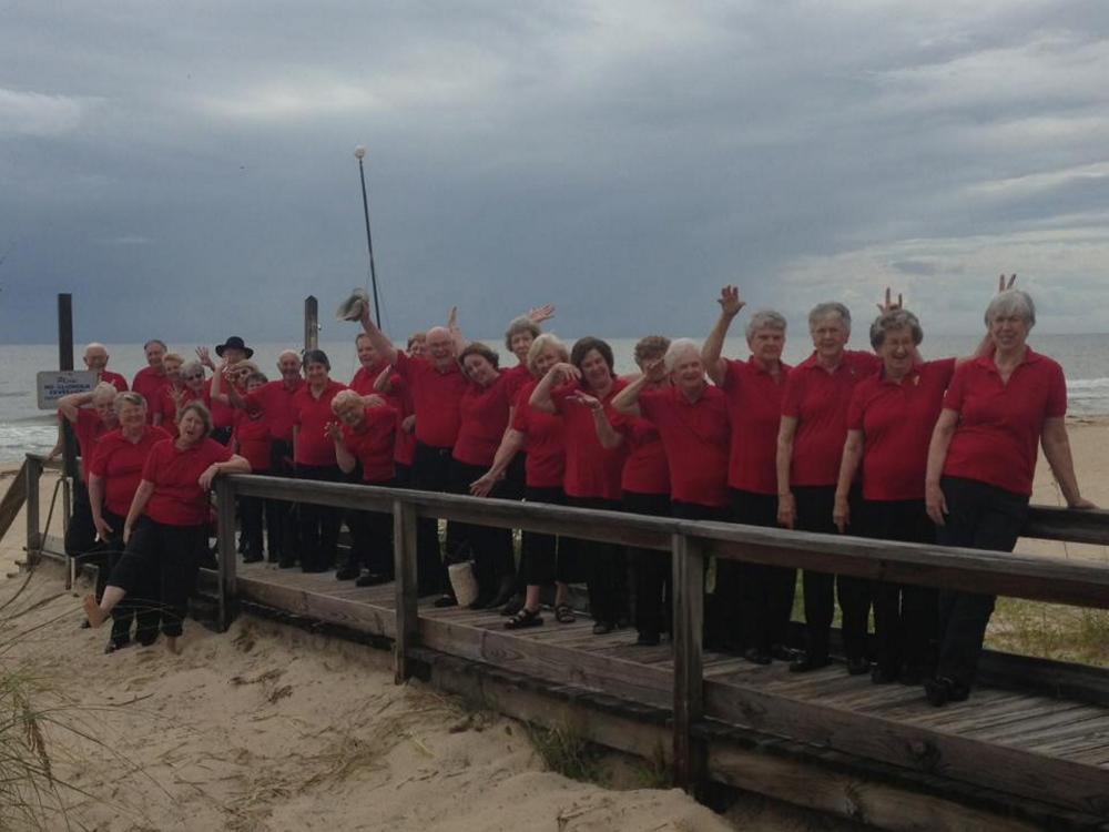 The First Joy Senior Adult Choir of the First Baptist Church of Tallahassee, Fla., step out for a some beach time. The 40-plus member group takes semi-annual  trips around the country to sing and to serve others. One of their specialties has been building handicap accessible ramps.