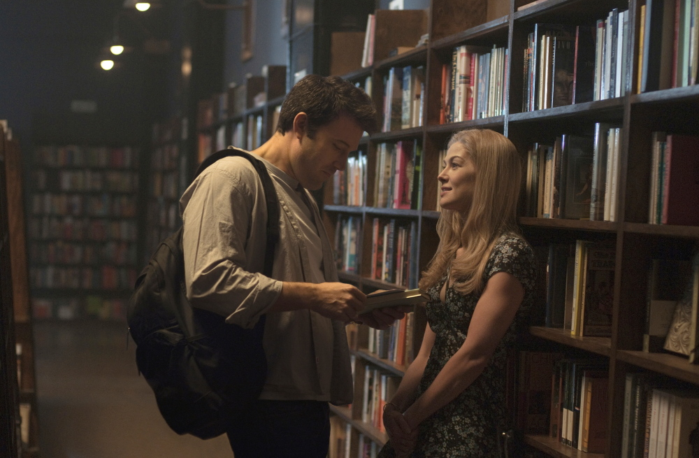 """Ben Affleck and Rosamund Pike appear in a scene from """"Gone Girl."""" The movie grossed $38 million in its U.S. debut."""